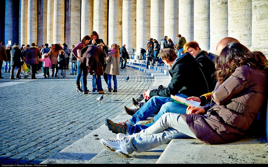 Tourists lying on the entrance of Saint Peter in Rome